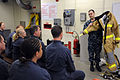 U.S. Navy Machinist's Mate 2nd Class Aaron Araiza, right, shows a firefighting ensemble to Sailors with the Executive Leadership Development Program during a tour of Submarine Learning Center Detachment San 140113-N-RC734-049.jpg