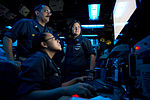 U.S. Navy Operations Specialist 2nd Class Yesenia Cruz, front, Senior Chief Operations Specialist Tom Aiello, left, and Operations Specialist 1st Class Jennifer Grieve send and receive messages in the combat 130629-N-WD757-045.jpg
