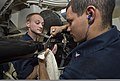 U.S. Navy Sonar Technician (Surface) 2nd Class Charles Granger, right, and Sonar Technician (Surface) 1st Class Christof Bessler inspect the locking bolt screws on a multi-functional towed array (MFTA) module 140103-N-PW661-017.jpg
