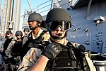 U.S. Sailors assigned to the visit, board, search and seizure team with the guided missile destroyer USS Halsey (DDG 97) prepare to depart from the ship in order to board two Yemeni dhows while performing 120205-N-RP435-043.jpg