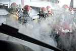 U.S. Sailors fight a simulated fire during a general quarters drill in the hangar bay of the aircraft carrier USS Harry S. Truman (CVN 75) March 8, 2014, in the Gulf of Oman 140308-N-ZG705-415.jpg