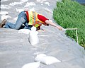 USACE materials engineer measures the elevation of a temporary emergency levee.jpg