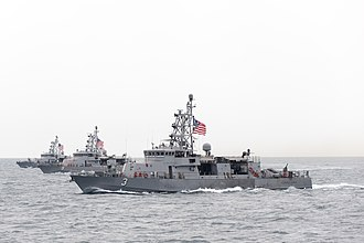Cyclone-class patrol ship - Image: USS Hurricane (PC 3), USS Typhoon (PC 5) and USS Chinook (PC 9) underway in March 2015