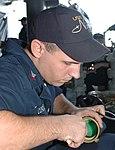 USS Nimitz docks in Bahrain DVIDS216544.jpg