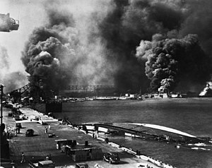 USS Helena (CL-50) - Helena at 1010 dock during the Japanese attack on Pearl Harbor, 7 December 1941.