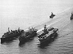 USS Vega (AF-59) replenishes Task Group 76.4 in the South China Sea, circa in early April 1975.jpg