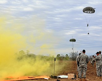 "United States Army Pathfinder School - ""Black Hats"" release colored smoke to show their students the wind drift on a parachute drop zones they have established"