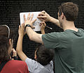 US Navy 030616-N-9593R-142 Visitors to the Vietnam Veterans Memorial Wall, take rubbings of the name, of a family member.jpg
