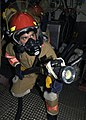 US Navy 031010-N-9214D-230 USS Shiloh (CG 67) damage control fire fighters practice firefighting skills during a main-space fire drill.jpg