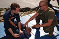 US Navy 031104-N-1693W-030 Lance Cpl. Michael Roy instructs on the correct way to force an assailant to comply with arrest.jpg