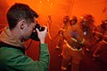 US Navy 040417-N-4308O-066 Photographer's Mate Airman Craig Spiering photographs a fire fighting hose team during a General Quarters (GQ) drill.jpg