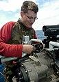 US Navy 040616-N-2972R-030 Gunner's Mate 3rd Class Marc Gent, from Norman, Okla., adjusts a MK-38 25mm Machine Gun System (MGS).jpg