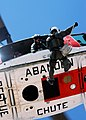 US Navy 040623-N-6060O-290 Search and Rescue (SAR) team member Hospital Corpsman 2nd Class Scott Heintschel, repels from an HH-1N Iroquois helicopter during training exercises.jpg