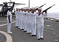 US Navy 050520-N-9860Y-046 The Amphibious command ship USS Blue Ridge (LCC 19) Weapons Officer, Lt.j.g. Gennine Williamson gives orders to the honor guard during a burial at sea ceremony.jpg