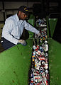 US Navy 050531-N-9293K-003 Fireman Brian Wilson of Charleston, S.C., separates bottles from aluminum cans at the Navy Recycling Center on board Naval Station Everett, Wash.jpg