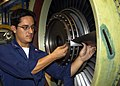 US Navy 050920-N-1126D-003 Aviation Machinist's Mate 2nd Class Juan C. Loja replaces a compressor blade on a TF-34-GE-400B turbofan engine at Aviation Intermediate Maintenance Department (AIMD).jpg