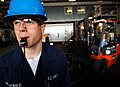 US Navy 060221-N-2984R-006 Seaman Joshua Macdonald blows a whistle to warn Sailors that forklifts are moving through the hangar bay aboard the Nimitz-class aircraft carrier USS Harry S. Truman (CVN 75).jpg