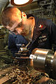 US Navy 060420-N-9723W-167 Machinery Repairman 2nd Class Cody Sterling repairs a valve using a lathe.jpg