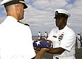 US Navy 061110-N-3285B-065 The Command Master Chief Billy Hill, assigned to the Oliver Hazard Perry-class frigate USS Stephen W. Groves (FFG 29) hands a flag to the ship's Commanding Officer, Cmdr. Jon Kreitz, during a burial a.jpg