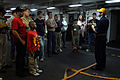 US Navy 070417-N-3659B-310 Chief Electronics Technician Andrew Belanger, a member of the Damage Control Training Team aboard USS Ronald Reagan (CVN 76), teaches shipboard fire fighting techniques to a group.jpg