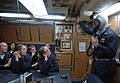 US Navy 070727-N-4163T-139 Midshipmen are instructed on the proper way to don an Emergency Air Breather (EAB) aboard the Los Angeles-class attack submarine USS Helena (SSN 725).jpg