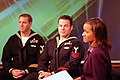US Navy 071006-N-7163S-001 Navy Divers 1st Class Josh Harsh (left) and Brian Bennett both attached to Mobile Diving and Salvage Unit (MDSU) 2 are interviewed by Dawn Stevens for the news program FOX 9 morning.jpg