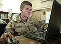 US Navy 071222-N-3857R-001 Personnel Specialist 3rd Class Ray Guedry, assigned to Naval Mobile Construction Battalion (NMCB) 1, manages the units pay and allowances on board Camp Ramadi.jpg