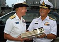 US Navy 080616-N-3581D-273 Royal Thai Navy Rear Adm. Thanarat Ubol, right, presents a gift to Rear Adm. Nora Tyson, commander, Logistics Group Western Pacific, following the closing ceremony for the second phase of Cooperation.jpg