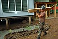 US Navy 080808-N-7498L-120 Boatswain Mate Seaman Michael Labeef, from Hannibal, N.Y., assigned to Amphibious Construction Battalion (ACB) 1, walks through Pari Village.jpg