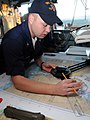 US Navy 090113-N-9758L-025 Quartermaster 3rd Class Joe Corrow plots a navigational course.jpg