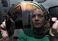 US Navy 090114-N-2908M-003 Aircrew Survival Equipmentman 1st Class Denise Foote cleans and inspects pilot's face shields aboard the aircraft carrier USS Theodore Roosevelt (CVN 71).jpg
