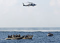 US Navy 090212-N-1082Z-066 Visit, board, search and seizure (VBSS) team members from the guided-missile cruiser USS Vella Gulf (CG 72) close in on rigid-hulled inflatable boats to apprehend suspected pirates.jpg