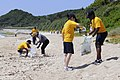 US Navy 090504-N-4918C-058 Sailors from amphibious command ship USS Blue Ridge (LCC 19) and embarked Seventh Fleet staff cleaning up White Beach in Okinawa, Japan.jpg