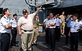 US Navy 090610-N-0869H-046 Capt. Keith Walzak, Ship's Master of the Military Sealift Command auxiliary fleet support ship USNS San Jose (T-AFS 7), explains features of the ship to members of the Republic of Singapore Navy.jpg