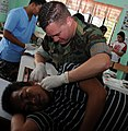 US Navy 100224-N-1008D-032 Chief Hospital Corpsman Michael A. Walls, assigned to Joint Special Operations Task Force-Philippines, removes a cyst on a male patient during a medical civic action project in Barangay, Taluksangay.jpg