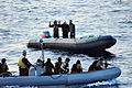 US Navy 100525-N-0000X-003 Boaters agree to a consensual boarding of their ridged-hull inflatable boat by a visit, board, search and seizure team from the guided-missile frigate USS Elrod (FFG 55).jpg