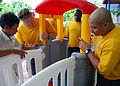 US Navy 100812-N-8539M-173 Sailors assigned to the guided-missile destroyer USS John S. McCain (DDG 56) work with staff members to construct new play equipment.jpg