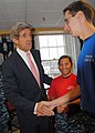 US Navy 101214-N-5647H-411 U.S. Senator John Kerry shakes hands with Airman Bryan Pickett in the galley for USS Constitution Sailors.jpg