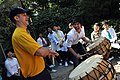US Navy 111002-N-WW409-191 Aviation Ordnanceman 2nd Class Eric Glender, from Cincinnati, plays the drums with children during a community service e.jpg