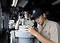 US Navy 111008-N-KB052-153 Republic of Korea navy Lt. Wook Hyun Min uses an alidade from the pilothouse of the Ticonderoga-class guided-missile cru.jpg