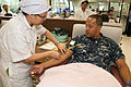 US Navy 111026-N-EA192-043 Lt. j.g. Justan Caesar, assigned to the guided-missile destroyer USS Mustin (DDG 89), donates blood to the Thai Red Cros.jpg