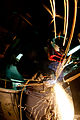 US Navy 111128-N-OY799-092 Hull Maintenance Technician Fireman Tom Fields, from Brinnon, Wash., uses a plasma cutter in the sheet metal shop aboard.jpg