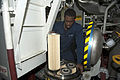 US Navy 120128-N-AP176-047 Gas Turbine System Technician (Mechanical) Fireman Derrick Willis changes fuel filters on a gas turbine generator aboard.jpg