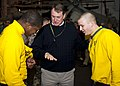 US Navy 120128-N-FI736-787 Butch Davis, a former NFL coach, and current head football coach at the University of North Carolina, shows Sailors his.jpg