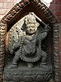 Vajrapani at the left side of door of entry in Swayambhu as a protector.jpg