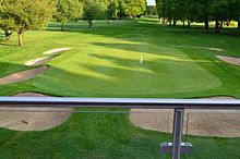 View of the 18th hole at Harpenden Common Golf Club.jpg