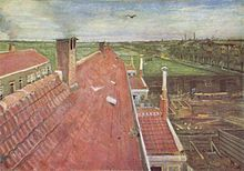 A view from a window of pale red rooftops. A bird flying in the blue sky and in the near distance fields and to the right, the town and other buildings can be seen. In the distant horizon are chimneys.