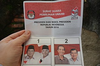 2014 Indonesian presidential election - A voting bulletin just after the official closing of elections at a voting station in Jakarta. The bulletin is punched at section 1 (in favour of Prabowo Subianto)
