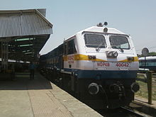 Modern locomotive at a station