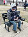 WTOP reporter filing story on park bench Inauguration 2013.jpg